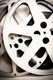 Movie film reels empty vintage effect. On neutral background vertical frame Royalty Free Stock Photos