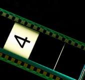 Movie filmstrip. Filmstrip movie header with the number 4 royalty free stock images