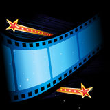 Movie grand premiere. Illuminated big cinema film at starry background Royalty Free Stock Photos