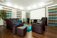 Movie at home. Picture of luxury family room with movie at home royalty free stock photography
