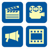Movie icon set. Movie production icon set with clapperboard, movie camera, megaphone and film strip isolated on white background Stock Photography