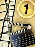 Movie industry. Cinema themed composition, including a slate and some blank film. Digital illustration Stock Photography