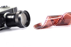 Old camera and film strip isolated Stock Image