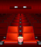 Movie love-seat. Empty chairs inside movie theater with highlighted love-seat Stock Photography