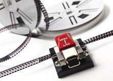 Movie maker. Closeup image on classic 8mm movie film and cutter stock photography
