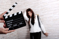 Movie model. Photographed in studio, movie clapper board Stock Images
