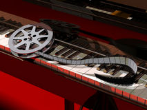 Movie Music. A film roll put on a piano keyboard, symbolising the movie music, soundtracks or scores vector illustration