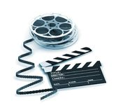 Movie night. 3D render of a clapper board and film reels Royalty Free Stock Photo