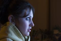 Movie night. Teenage girl at home watching some tv royalty free stock photography