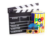 Movie night. Movie clapper board, box of popcorn and a DVD disc with 3d glasses Stock Images
