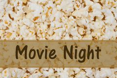It is Movie Night. Message, Popcorn background and text Movie Night Royalty Free Stock Photos