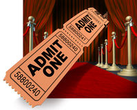 Movie Night Red Carpet. Movie night on the red carpet with a dynamic roll of admit one ticket stubs flying through the air against a background of velvet Royalty Free Stock Image