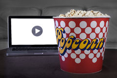 Movie online with popcorn Stock Photo