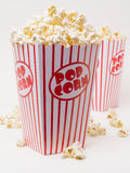 Movie Popcorn. A bucket over flowing with buttery popcorn, the classic movie theater snack Royalty Free Stock Images