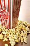 MOVIE POPCORN. Buttered movie popcorn in a popcorn cup royalty free stock images