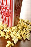 MOVIE POPCORN. Buttered movie popcorn in a popcorn cup royalty free stock photo