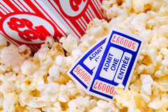 Movie Popcorn. Overflowing Box Of Movie Popcorn With Two Cinema Tickets Stock Images