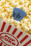 Movie Popcorn. Box of Butter Popcorn with Two Blue Movie Tickets Stock Photo