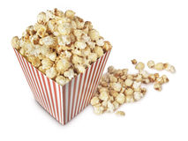 Movie Popcorn isolated on white. A movie theater popcorn box heaped with the fresh popped, crispy, salty, buttered snack Royalty Free Stock Images