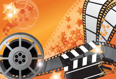 Movie poster. Movie background in orange with reel and film strips Royalty Free Stock Image
