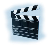 Movie production clapper board. On a blue background Stock Image