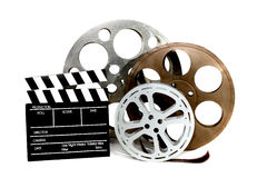 Movie Production Clapper and Film Tins on White royalty free stock photo