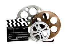 Movie Production Clapper and Film Tins on White Stock Photos