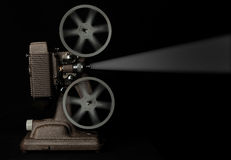 Movie projector. Vintage movie projector on white Stock Photos