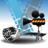 Movie projector and filmstrip. Abstract design with movie projector and film strips Stock Image
