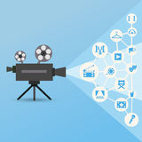 Movie projector with icons. Movie projector with blue light and cinema and theatre icons. Clean stylized illustration on blue background. Infographic concept Stock Photo