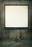 Movie Projector Screen. A blank movie screen on a concrete background Stock Images