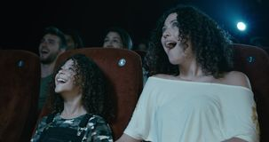 Movie Reactions. Mother and child reacts in wonder to movie at cinema stock video