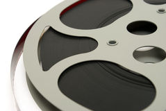 Movie Reel. A closeup shot of a 16mm movie reel for projection playing at theaters stock photos