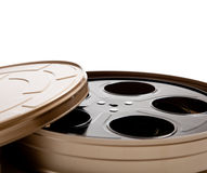 Movie reel canister on white with copy space. Canister with a movie reel on a white background with copy space royalty free stock photo