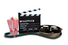 Movie reel with clapboard and popcorn royalty free stock photos