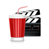 Movie reel and cola glass with straw Royalty Free Stock Photography