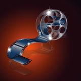 Movie reel film  with reflection isolated on red background.  Stock Photos