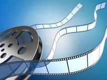 Movie reel and filmstrips. Film reel and filmstrips on blue background Royalty Free Stock Image