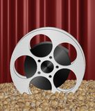 Movie reel in popcorn Stock Images