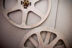 Movie reels part with filmstrip on 16 mm film projector detail Royalty Free Stock Photo