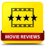 Movie reviews yellow square button red ribbon in middle. Movie reviews isolated on yellow square button with red ribbon in middle abstract illustration Royalty Free Stock Photography