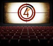 Movie Screen countdown in old retro cinema. View from audience Stock Photo