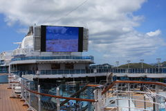 Movie screen on the cruise ship. This big screen on the cruise ship is 3 story high with perfect sound system Stock Images