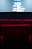 Movie screen and red chairs inside of a cinema Royalty Free Stock Photography