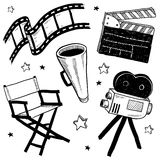 Movie set objects vector. Doodle style movie set equipment sketch in vector format. Set includes clapperboard, director's chair, megaphone, film strip, and Royalty Free Stock Photo