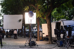 Spotlights, Entertainment - Movie Set at City Streets, TV Series. TV series street set in Lisbon - early evening. Tripod spotlights and white square reflectors royalty free stock photo