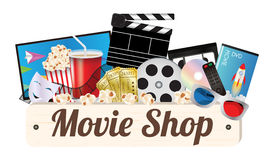 Movie shop wood board with pop corn film cd disc dvd movie box smart television film remote ticket emotion mask 3d glasses Royalty Free Stock Photography