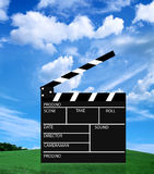 Movie slate. On sky background Stock Photo