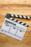 Movie slate film on wooden table Stock Images