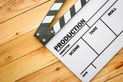 Movie slate film on wooden table Stock Photos